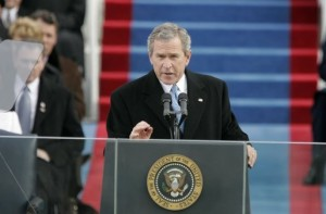President Bush behind a podium with the US seal