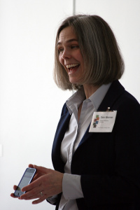 Woman Holding a Cell Phone and Smiling