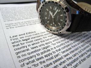 Law and Ethics Text with Watch