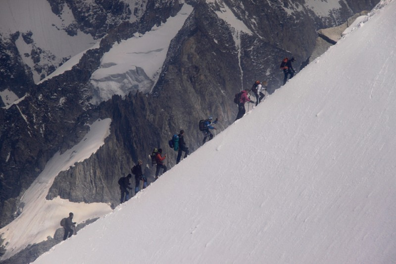 This photo shows a group of people climbing a mountain.