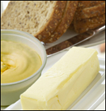 Stick of butter next to bread