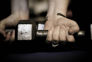 Hand lifting dumbbell