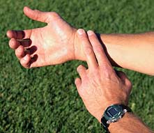 Two fingers on wrist at pulse point
