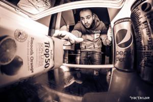 Man reaching into fridge to get orange juice