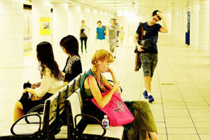 People sitting on bench in a subway station