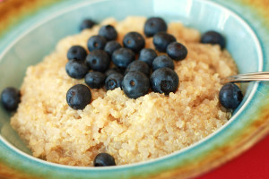 Bowl of quinoa topped with blueberries