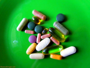 Various vitamins on a green background
