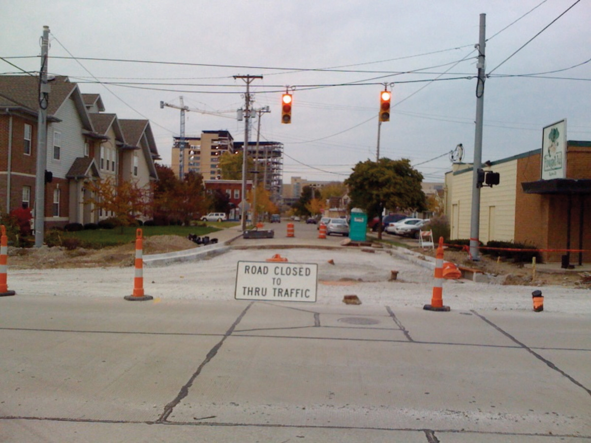 "Image showing construction site on a road wit the sign ""Road Closed to Thru Traffic"""