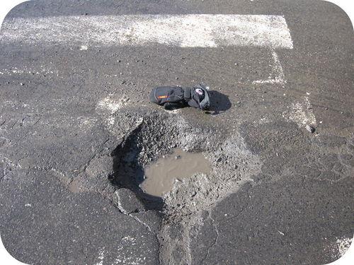 Um buraco em uma rua