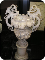 An intricately sculpted vase made of marble