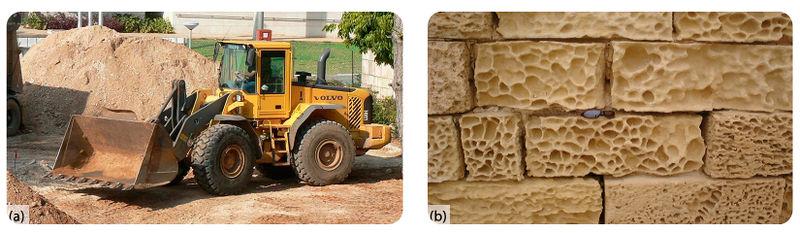 A) um trator. B) Tijolos com buracos espalhados em um padrão semelhante a uma teia