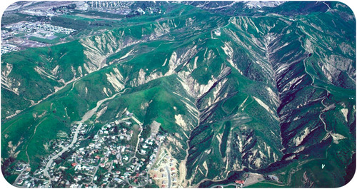 Green hills with white streaks