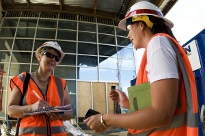 Women in hard hats on a construction site