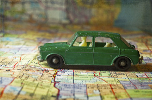 Toy car sitting on map