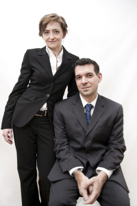 Woman and man wearing business attire