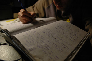 Man taking notes in book