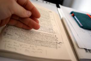 Book with handwritten notes in margins
