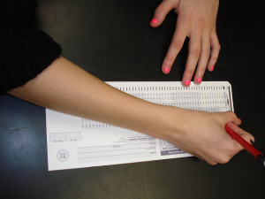Person filling in Scantron test form