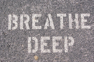 """Breathe deep"" printed on pavement"