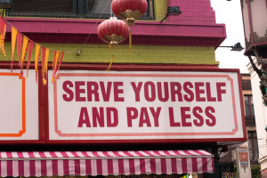 "Sign reading ""serve yourself and pay less"""