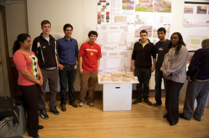 Group standing in front of architectural model