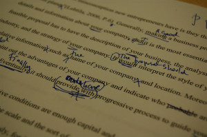 Typed essay with handwritten proofreading marks