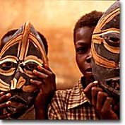 Ghanaian boys with traditional masks