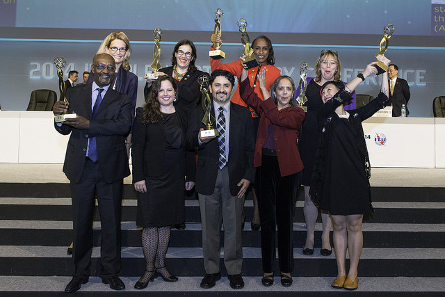 Group of adults holding trophies
