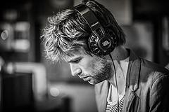 Man wearing headphones looking down