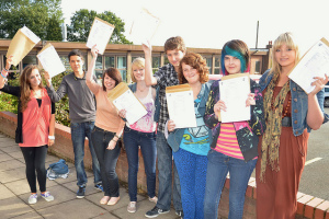 Students holding envelopes with test results