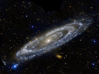 A typical spiral galaxy with stars and other galaxies visible in the far distance.