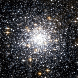globular cluster; the cluster of stars gets increasingly brighter nearer to the center of the cluster