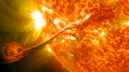 A solar flare: a corona, a long filament of solar material, erupting out from the sun into space.