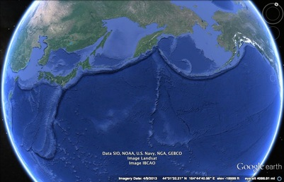 Edge of the pacific plate along Asia and North America. The edge of the plate is visible as a deep oceanic trench. The Mariana trench is found along this boundary.