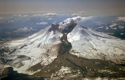 An explosive eruption on March 19, 1982, sent pumice and ash 9 miles (14 kilometers) into the air, and resulted in a lahar (the dark deposit on the snow) flowing from the crater into the North Fork Toutle River valley. Part of the lahar entered Spirit Lake (lower left corner) but most of the flow went west down the Toutle River, eventually reaching the Cowlitz River, 50 miles (80 kilometers) downstream.