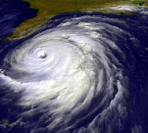 A large spiral shaped cloud. The spiral is so tightly wound it looks like a solid mass. There is an eye in the center of the hurricane.