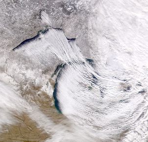 The rising bands of moistened, warmed air that drop lake-effect snow alternate with clear bands of falling cold air.