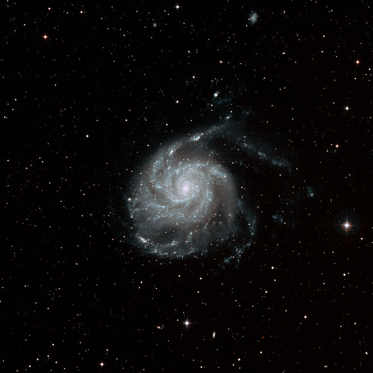 a face-on spiral galaxy about 27 million light-years away in the constellation Ursa Major