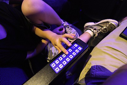 An American Idol audience member voting for a contestant using an electronic response system that uses numbers as answers
