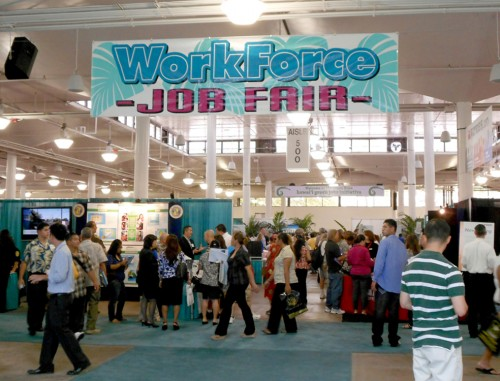 A group of people at a job fair are shown here.