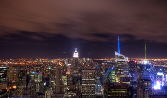 The New York City skyline at night is shown here.
