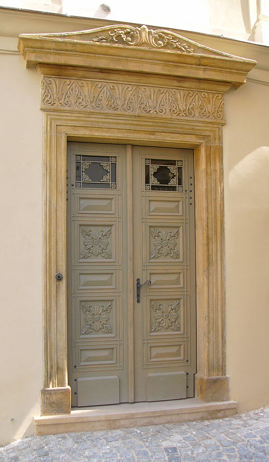 Figure 2. Classicist door in Olomouc, The Czech Republic. An example of Classicist architecture.