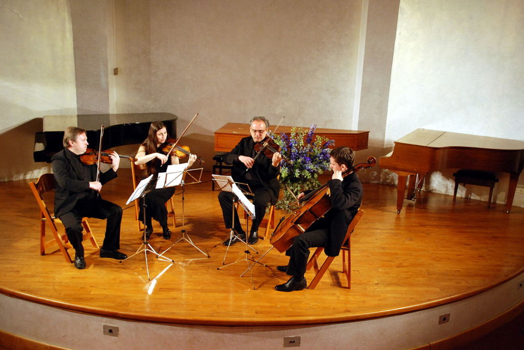 Figure 1. A string quartet in performance. From left to right—violin 1, violin 2, viola, cello