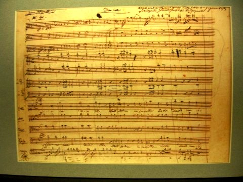 Figure  6. A facsimile sheet of music from the Dies Irae movement of the Requiem Mass in D minor (K. 626) in Mozart's own handwriting. It is located at the Mozarthaus in Vienna.