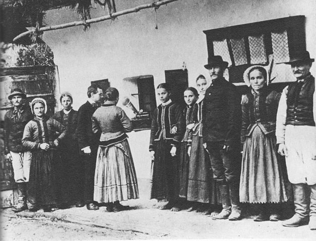 Figure 2. Béla Bartók using a gramophone to record folk songs sung by peasants in what is now Slovakia.