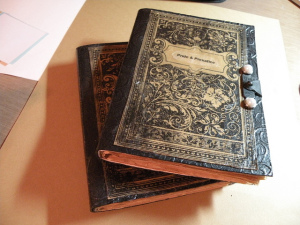 "Photo of two stacked handmade books, the top one with the title ""Pride and Prejudice"""
