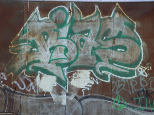 """graffiti on wall spelling out """"Bias"""""""