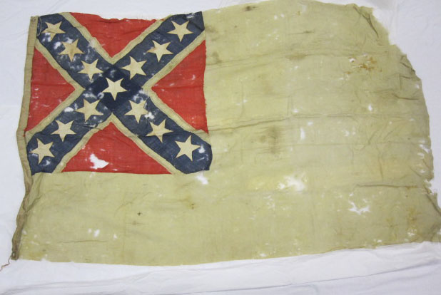 Photo of a tattered Confederate flag