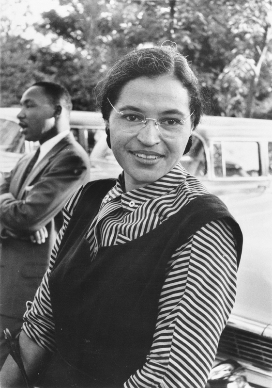 black-and-white photo of Rosa Parks and Dr. Martin Luther King, Jr. (somewhat in the background)