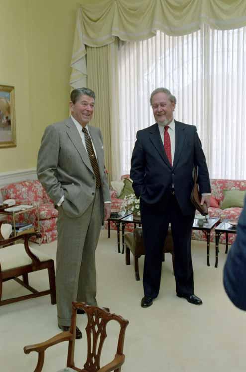 Photo of President Reagan standing beside Robert Bork.